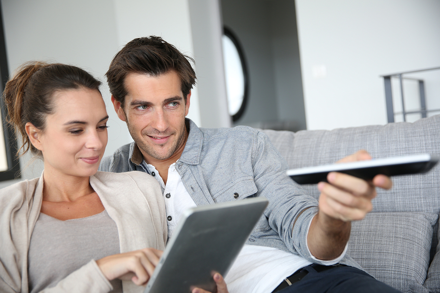 bigstock-Couple-looking-for-tv-program--53335036